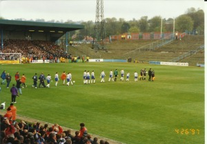 Team walking out for the last time at the Goldstone Ground