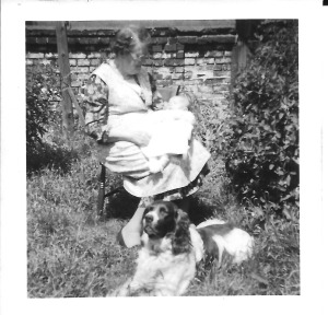 Winifred Howells holding me at age 6 weeks, with dog.