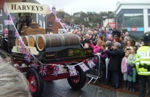 Harveys beer barrels on the back of the cart.