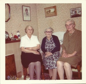 Three of the Cleeve sisters left to right: Annie, Edith and Rose with Dora's picture on the wall.