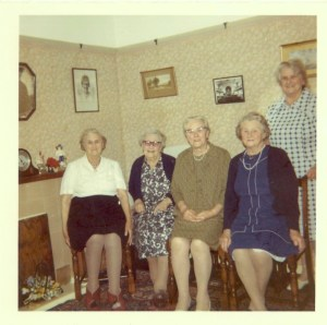 The Cleeve sisters, left to right Annie, Edith, Rose, Olive and Grace. The photo of Edith's daughter, Dora is above Annie's head.