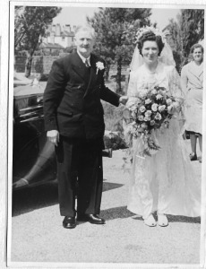 The bride (Enid May Howells) arrives at the church with her father, Jack Howells