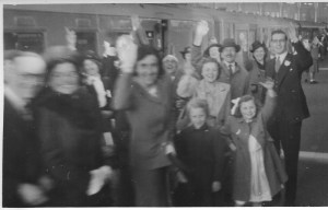 Wedding guests waving goodbye to Bert and Nancy as they leave for their honeymoon from Brighton station. You can make out Nancy's brother, Ron on the right, and behind him you can see Enid May Howells - my mother.
