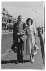 Gordon and Enid on their honeymoon, with their bags.