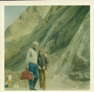 Dad and me on holiday at Alum Bay, the Isle of Wight. With a very nice red bag.