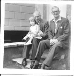 Here I am sitting on Dad's knee (Gordon) alongside Dave Howells.