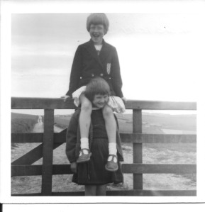 Here I am sitting on a fence, my legs astride Karen!
